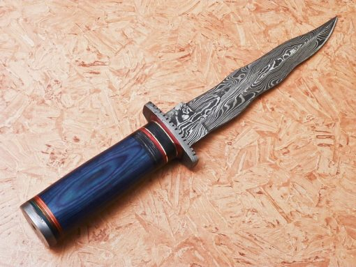 Blue Laminated wood and Damascus Bolster and But cap.