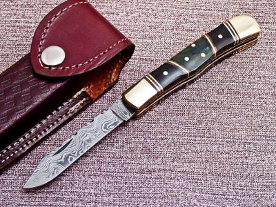 Damascus Folding knife with Buffalo Horn, Brass bolster Handle and a Damascus Blade
