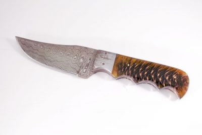 Resin and Pine cone handle with Damascus Bolster