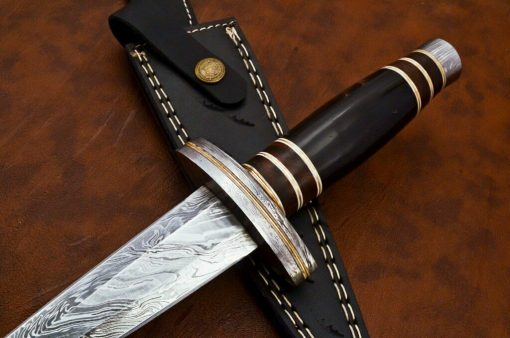 Damascus dagger It is made of Buffalo Horn and Damascus Hilt and pommel