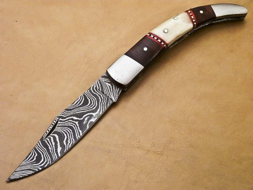 Gorgeous handle of bone and Walnut Wood . Knife is a gorgeous beautiful Hand made steel bolsters
