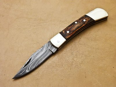 Damascus Pocket Knife Brass Bolsters and laminated Wood Handle