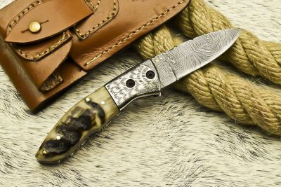 Rams horn Damascus Folding Knife with engraved steel bolster