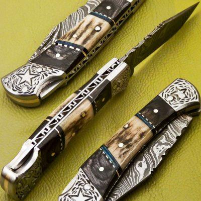 Damascus Pocket Knife Deer Antler and black wood